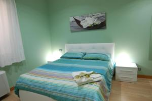 A bed or beds in a room at Vacanze Romane Olgiata