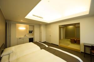 A bed or beds in a room at Court Hotel Asahikawa