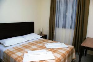 Postel nebo postele na pokoji v ubytování Hotel Priscapac Resort & Apartments