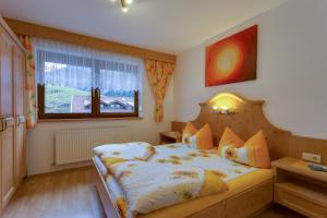 Кровать или кровати в номере Haus Berthold