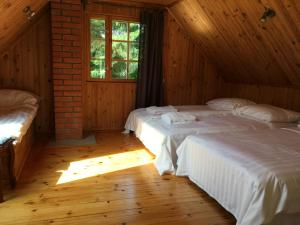 Voodi või voodid majutusasutuse River Villa toas