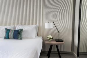 A bed or beds in a room at DoubleTree by Hilton Melbourne