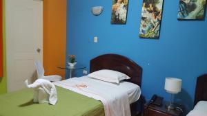 Un ou plusieurs lits dans un hébergement de l'établissement Hotel Embajador