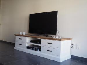 "A television and/or entertainment center at Appartement ""FD"""