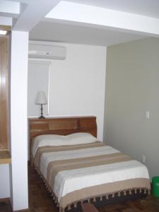 A bed or beds in a room at Monoambientes Cuauhtemoc