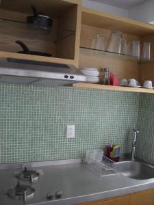 A kitchen or kitchenette at Monoambientes Cuauhtemoc