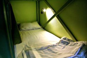 Кровать или кровати в номере Хостел Заходи на Павелецкой