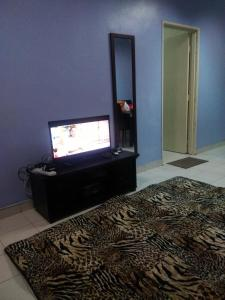 A television and/or entertainment center at Comfort Homestay