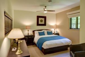Un ou plusieurs lits dans un hébergement de l'établissement Plumes et Glisse