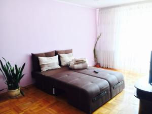 A bed or beds in a room at Galytska Apartment