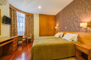 Cama o camas de una habitación en Hotel Avenida Park