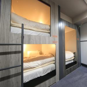 A bunk bed or bunk beds in a room at Beagle Tokyo Hostel&Apartments