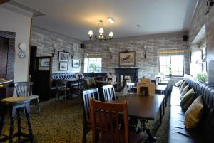 A restaurant or other place to eat at The Broadoak Hotel