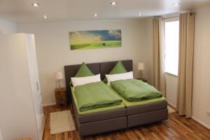 Ein Bett oder Betten in einem Zimmer der Unterkunft Pension Stauber