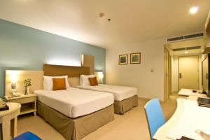 A bed or beds in a room at Sunshine Vista Hotel