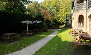 A garden outside Red Lion, Wigan by Marston's Inns