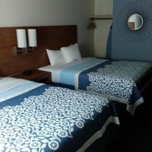 A bed or beds in a room at Mainstreet Inn