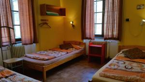 A bed or beds in a room at Hostel Merlin
