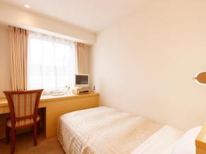 펄시티 아키타오마치 호텔 객실 침대