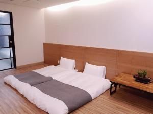 A bed or beds in a room at Hotel Ciel