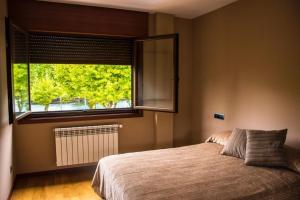 A bed or beds in a room at La casa del río
