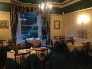 A restaurant or other place to eat at Rostrevor Hotel - Guest House