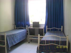 A bed or beds in a room at Apartamento Edificio Mirage