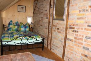 Ein Bett oder Betten in einem Zimmer der Unterkunft Ferienhaus Anno Dazumal, wie zu Oma`s Zeiten