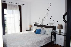 A bed or beds in a room at OLIVO 15H