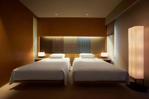 A bed or beds in a room at Hyatt Regency Kyoto