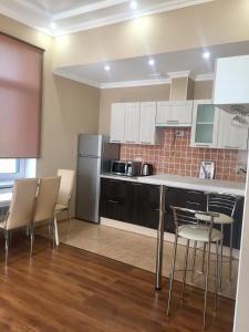 Кухня или мини-кухня в Отель на Сорокина
