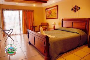 Cama o camas de una habitación en Hotel Los Héroes