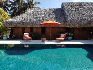 The swimming pool at or near Villa Lagon by Tahiti Homes