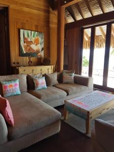 A seating area at Villa Lagon by Tahiti Homes