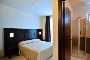 A bed or beds in a room at Hotel I Crespi