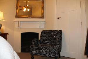 A seating area at Mentor Chambers Apartment Bed & Breakfast