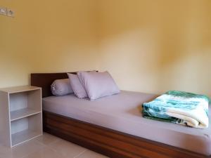 Ein Bett oder Betten in einem Zimmer der Unterkunft Radiya Guesthouse