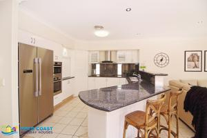 A kitchen or kitchenette at Gold Coast Waterfront Paradise