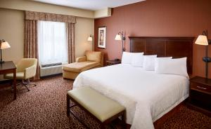 A bed or beds in a room at Hampton Inn by Hilton North Bay