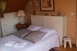 Un ou plusieurs lits dans un hébergement de l'établissement Le Kiosque Amiens chambres d'hôtes
