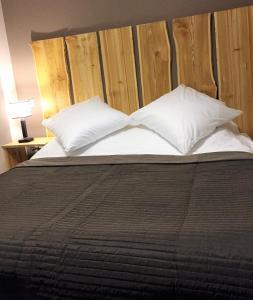 Кровать или кровати в номере Hotel Yasenki