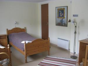 Säng eller sängar i ett rum på Dockstabaren Hotel