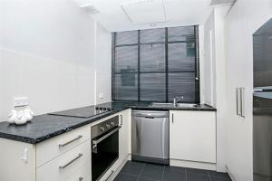 A kitchen or kitchenette at Apartment Bridge Street 4 CLD01