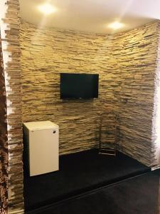 Телевизор и/или развлекательный центр в Central Hotel