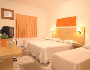 A bed or beds in a room at Hotel Cabreúva Resort