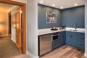 A kitchen or kitchenette at Hilton University of Florida Conference Center Gainesville