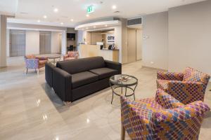 A seating area at City Edge Dandenong Apartment Hotel