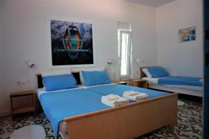 A bed or beds in a room at Quercus Apartment