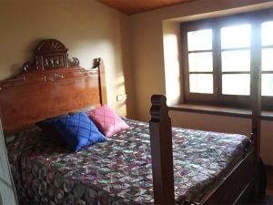 Una cama o camas en una habitación de Pla de Moixons