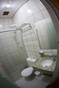 Um banheiro em Hotel Esplanada